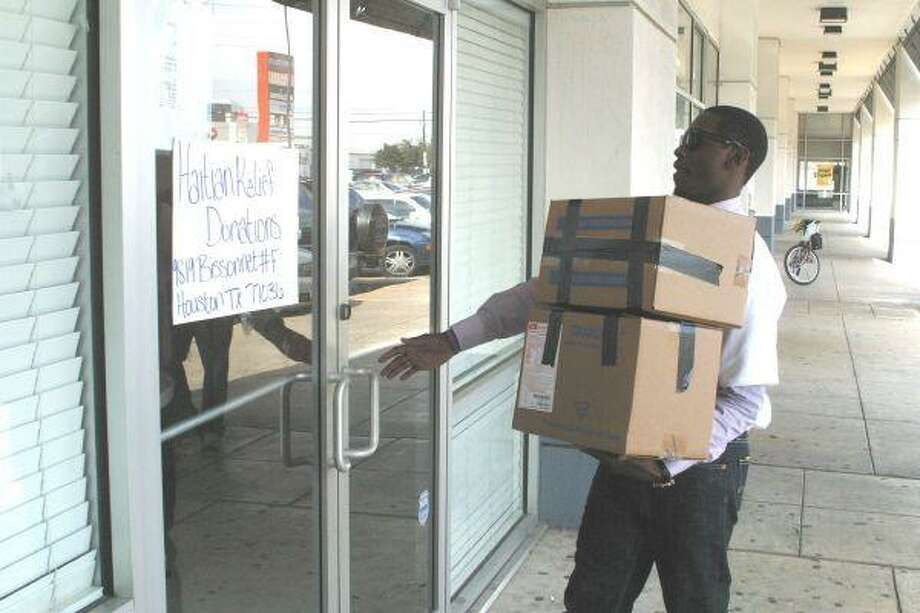 Donations arrived steadily Wednesday at the Haitian cultural facility, suddenly a relief center.