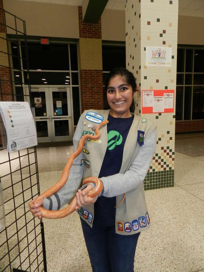 Kalpana Vaidya holding a snake at the Baytown Nature Center exhibit