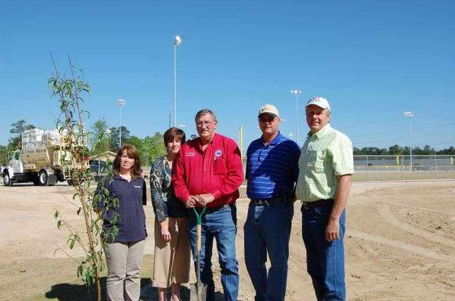 Sandra Creasy, Jana Lee, Ed Rinehart, Gant Austin and David Kleimann attend the tree planting at the new EMC softball, baseball and T-ball fields.