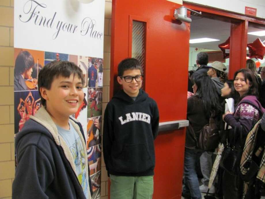 Lanier 8th graders Mitchell Krall, left, and Benjamin Schwierking prepare to enter the jamboree, a new addition this year to Bellaire High School's prospective student night. Photo: Robin Foster