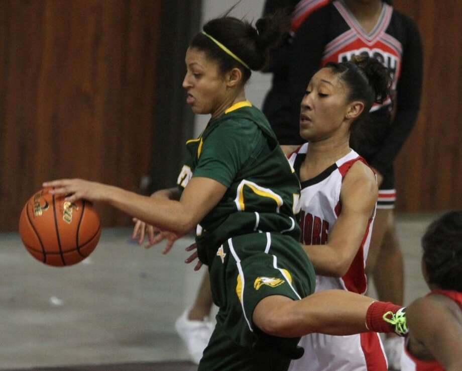 Cy Falls Loryn Goodwin (32) grabs a rebound over North Shore's Brashae' Adams (41) during the girls' basketballRegion III-5A regional semifinal game at the M.O. Campbell Education Center on Feb. 24. Cy Falls defeated North Shore 50-27.