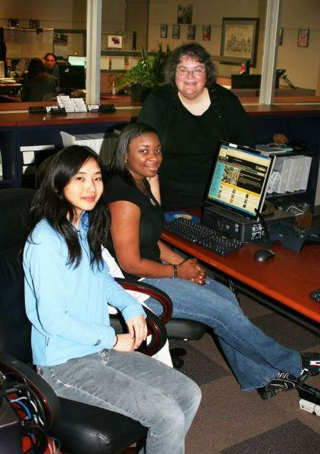 UHD students Melinda Chin (left) and LaToya Green (center) are looking forward to participating in human genetics research at Argonne National Lab near Chicago this summer with UHD Associate Professor of Mathematical Science, Erin Hodgess (right).