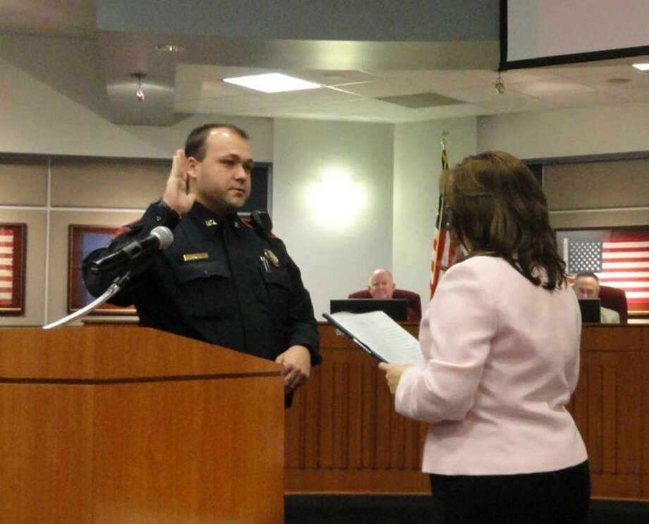 Officer Ryan P. Gonzales is sworn-in by the Katy ISD Secretary for Board Services during the January Board of Trustees' Work Study meeting. Photo: Kim Guillaume