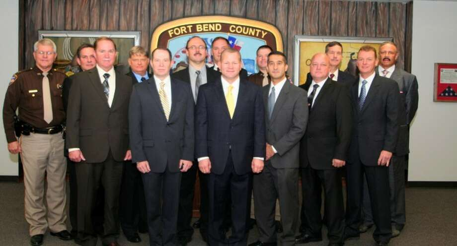 Members of the Command Staff under new Fort Bend County Sheriff Troy E. Nehls were sworn in Tuesday morning. Members of the staff include, from left, Captain Danny Jan, Emergency Management; Captain James Burger, Criminal Investigation Division; Captain Mike Patton, Academy; Captain Robin Frazier, Support Services; Major Thomas Goodfellow, Detention Division; Chief Deputy David Marcaurele; Captain Steven Holtz, Patrol Division; Sheriff Troy E. Nehls; Captain Robert Becker, ID and Records; Ozgur K. Bayazitoglu, Reserves Chief; Major Chad Norvell, Administration; Captain Jule Brownfield, Detention; Major James Hines, Enforcement; and Captain Geoffrey Jackson, Detention. Not pictured is Captain Paul Mosley, Internal Affairs Division. Photo: Picasa