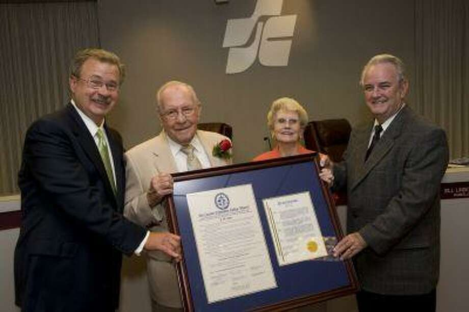 J.D. Bruce (second from left) receives a plaque of appreciation from San Jacinto College Chancellor Bill Lindemann (far left) and Pasadena Mayor Johnny Isbell (far right) for his years of service to San Jacinto College. Bruce's wife, Lela, joined him during the presentation.
