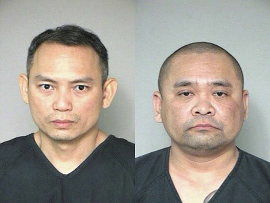 Dong Tien Nguyen (left) and Duyet Nguyen (right) were arrested and booked into the Fort Bend County Jail on first degree felony charges of Possession of Marijuana. The marijuana seized at the scene had a street value of approximately $824,000. Photo: Submitted Photo