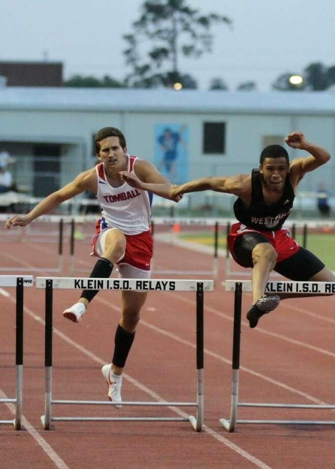 Tomball junior Adrian Austin (left) edged Westfield's Crayton Johnson at the finish line to win the 300-meter hurdles. Austin also won the 110 hurdles.