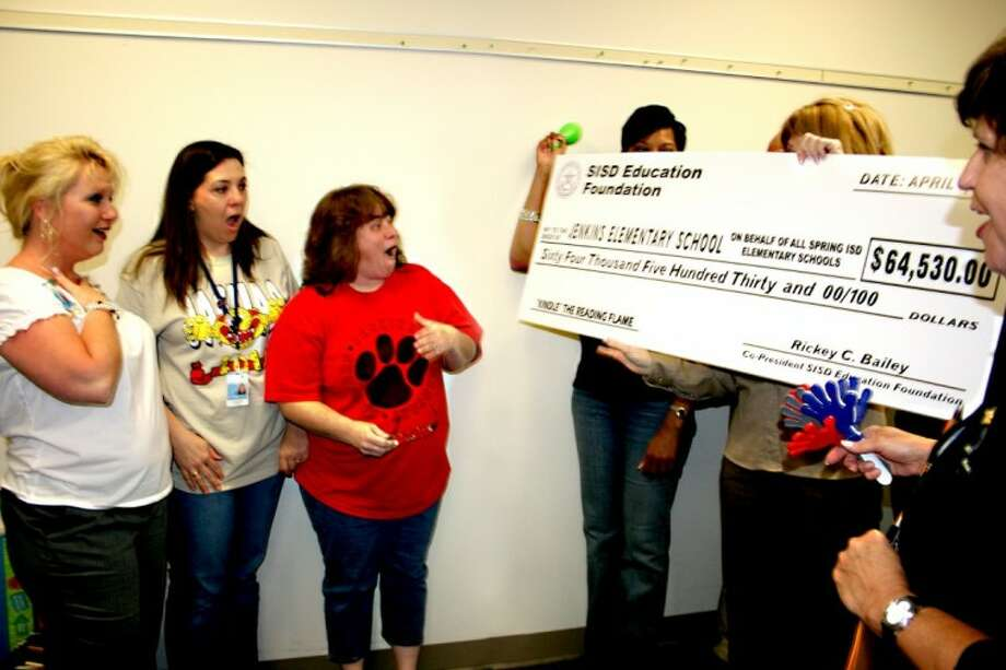 Jenkins Elementary School Principal Michelle Starr, left, and teachers Christine Grant and Teresa Caronna express their surprise when a grant worth 64,530 is delivered to their school by the Spring ISD Education Foundation.