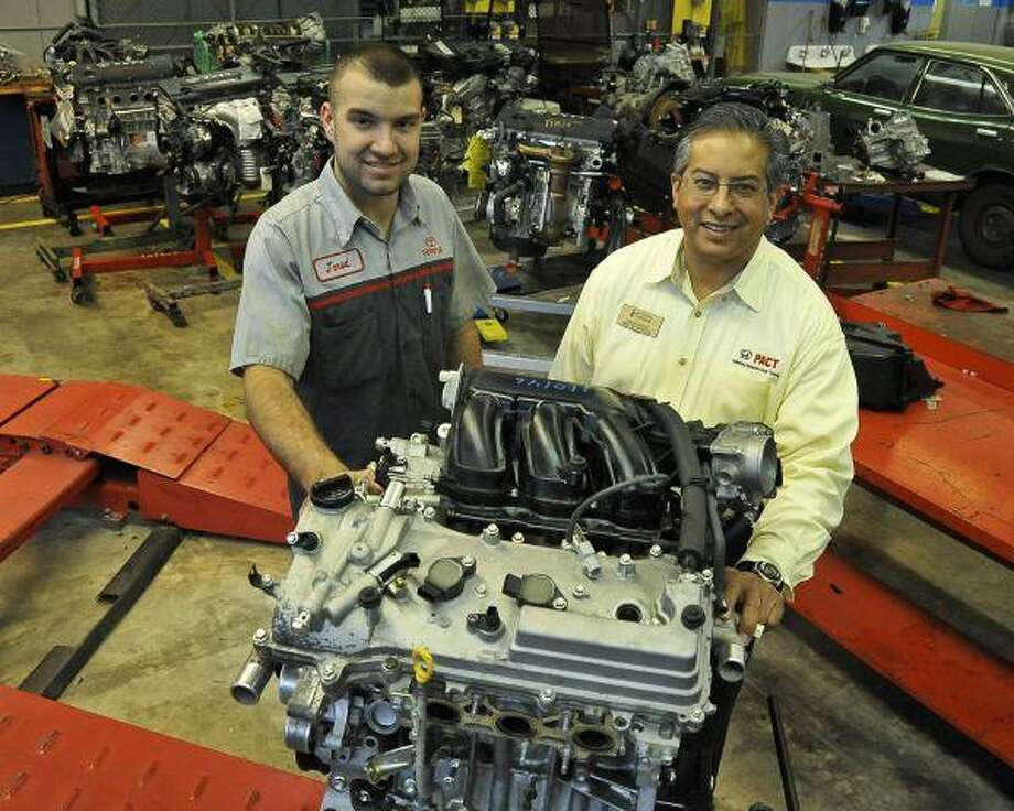 San Jacinto College student Jared Mouser, left, won the SkillsUSA state contest with guidance provided by the College's auto technology instructor David Castillo. / 2008