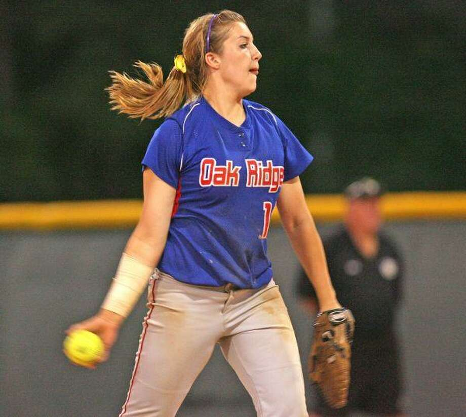 Oak Ridge's Tina Schulz, the 2009 County MVP, pitches against Conroe last year. / The Courier