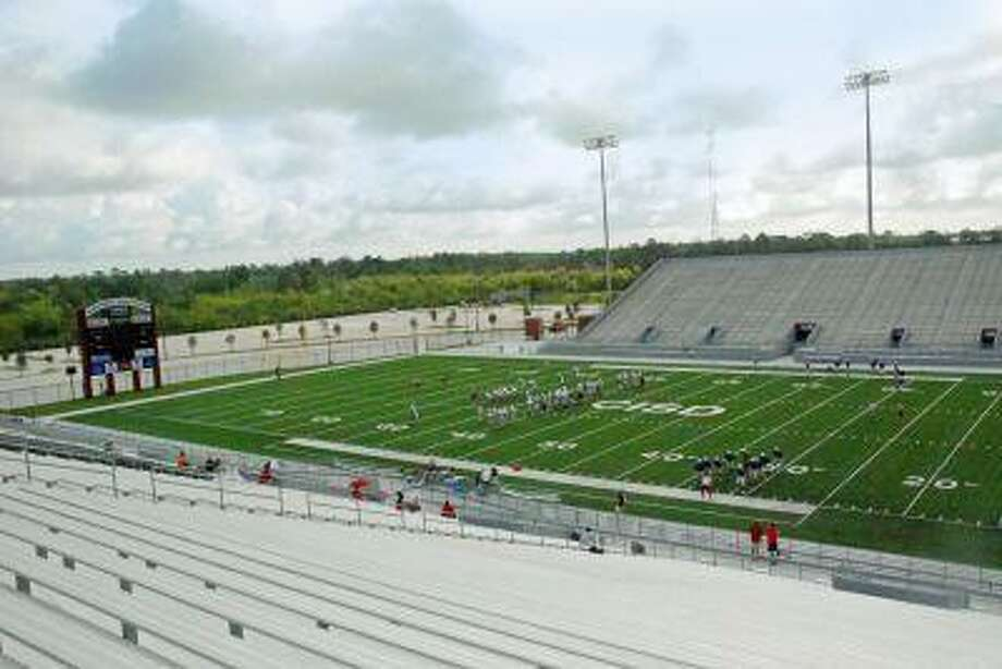 The Oak Ridge football team enjoys its first workout on the field at Woodforest Bank Stadium Saturday morning.