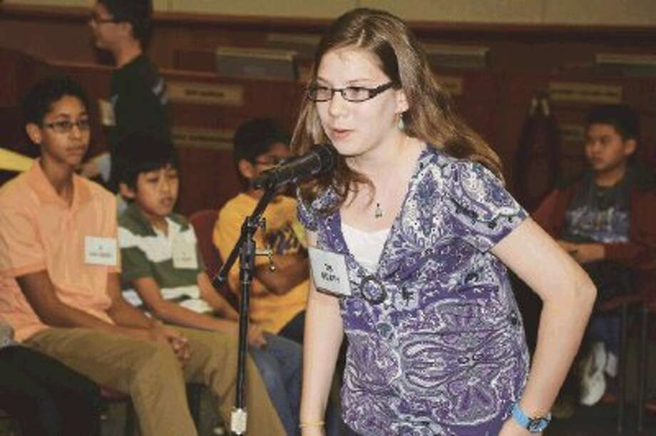 """Bleyl Middle School seventh-grade student Laura Beaty won the Middle School Spelling Bee on Thursday, correctly spelling """"gesundheit"""" in the 29th round."""