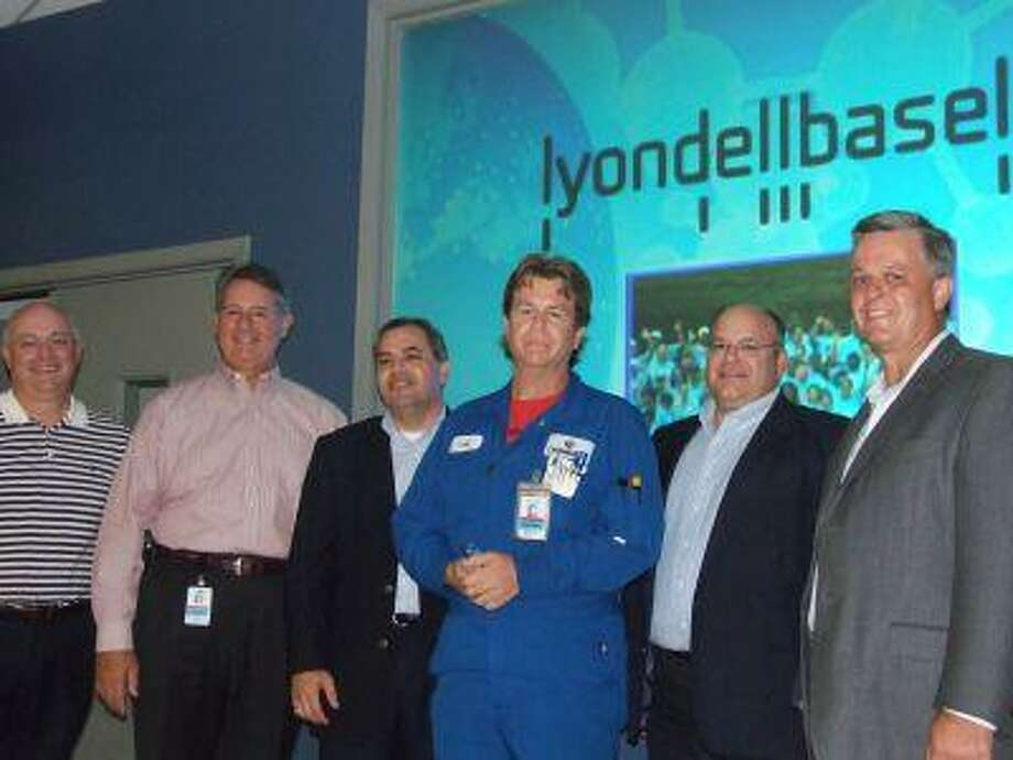 The management team of LyondellBasell's Channelview complex presented employee Jake Boyd (center) with the company's Volunteer of the Year award at Monday's luncheon. Pictured with Boyd are (from the left) plant manager Denny Wiseman, vice president Joe Bernard and plant managers Ghazi Shahin, Peter Hentges and Mark Gaddy.