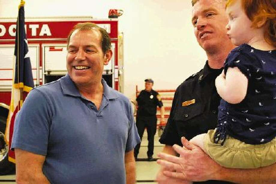 Larry Ledet shares a laugh with AVFD Capt. Jarrod Byrd, one of the men credited with saving his life after he suffered a heart attack at a local fitness center in October.