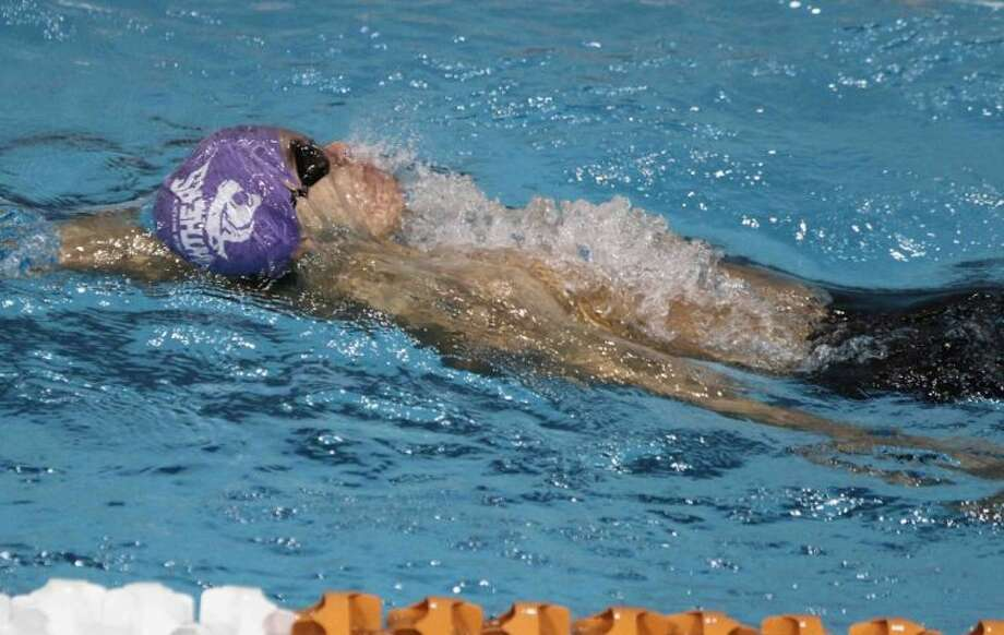 Ridge Point's Anthony Aranda won the 2013 bronze medal in the Class 4A boys 100-yard backstroke. Ridge Point will be represented in seven events at the 2014 state meet Feb. 21-22 at the University of Texas. Photo: Jason Fochtman/HCN