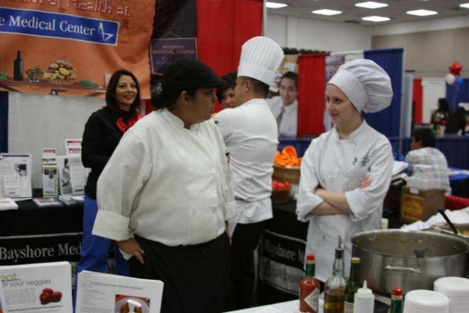 San Jacinto College Culinary Arts programs students visited with guests at the Bayshore Medical Center booth at the Pasadena Chamber of Commerce Expo held Thursday (Feb. 21). More photos page 5A. Photo: KRISTI NIX