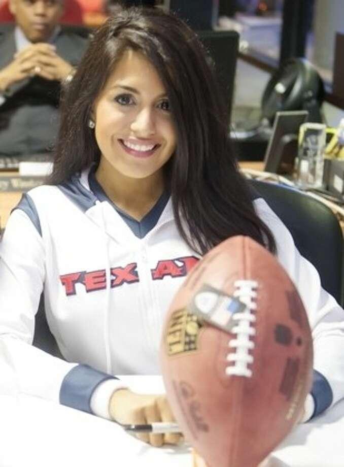 Texans cheerleader Stephanie Q. greeted customers at Advantage BMW Clear Lake on Wednesday (February 20). Photo: CJ MARTIN