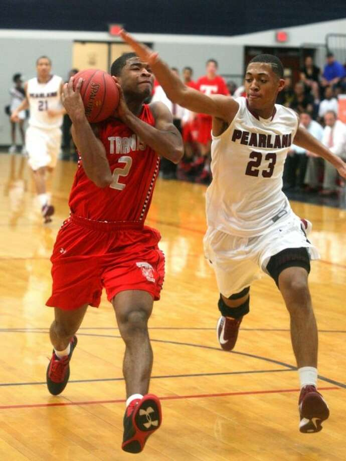 Pearland's Cameron Reynolds tries to slow the progress of Fort Bend Travis guard Aaron Harrison Friday in an area round basketball game. Photo: KAR HLAVA