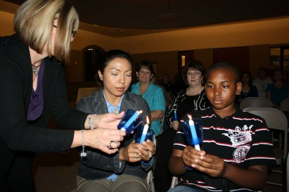 Community residents attended the annual candlelight vigil on April 12. The event was sponsored by the Liberty County District Attorney's office along with several other local organizations and law enforcement. The event honored National Crime Victim's Rights Week and Child Abuse Prevention month. Those that attended lit a candle for all the children and residents that were victims of abuse last year. Shown from left to right are Joan Belt, Dee Serrano Mullis and Wesley Smith.