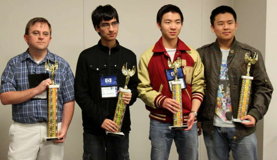 Cypress Woods High School computer science coach Ryan Hutt with the HP Code Wars 2013 winning team: Nikoli Sartagena (senior), Andrew Liu (junior) and Ben Lin (senior).To see more pictures from Saturday's competition, visitwww.yourhoustonnews.mycapture.com.