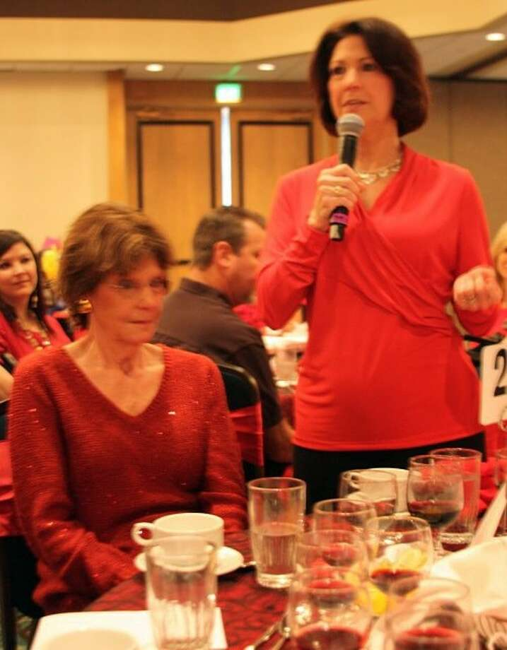 """A group of survivors of heart disease shared their personal stories at the American Heart Association's annual Bay Area Go Red For Women Luncheon on Friday (February 22).During the luncheon program, Clear Lake resident Cindi Gaskill-Hill told guests her survivor story began in 2005 as she and her mom were driving to the airport.""""I was driving down I45 in the middle of Houston traffic when my mother suddenly grabbed her chest and said she was having the worst pain she had ever experienced in her life,"""" she said. """"I grabbed her hand and told her to take deep breaths and then she passed out. Her mother's condition was eventually diagnosed as an aorta dissection. She was rushed to the operating room and endured a dangerous four and a half hour surgery to save her life. Just four weeks after her mother's diagnosis, Gaskill-Hill was admitted to the same hospital for treatment. """"I am here because the American Heart Association funded research and programs that saved my life,"""" she said. Photo: KRISTI NIX"""
