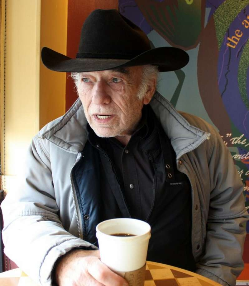 Actor James Drury enjoys a cup of coffee and conversation recently on a rainy day in Houston. Drury is marking the 50th anniversary of his long-running television show, The Virginian.
