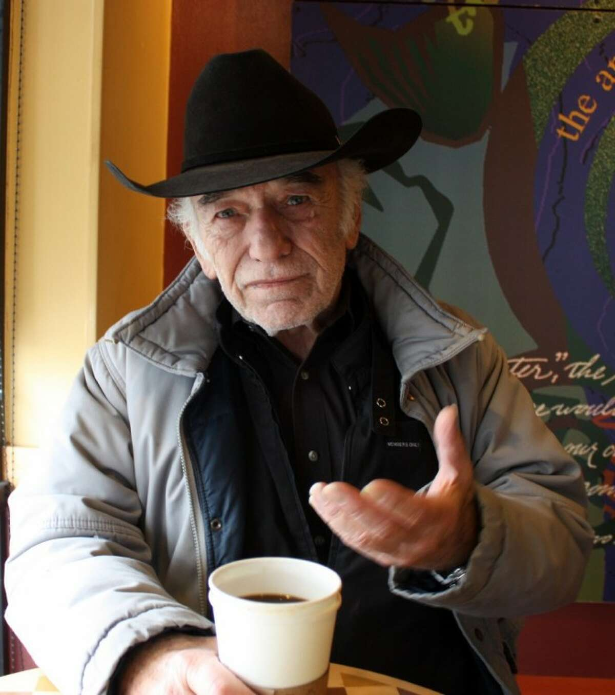 """Actor James Drury enjoys a cup of coffee and conversation recently on a rainy day in Houston. Drury is marking the 50th anniversary of his long-running television show, The Virginian. """"It was a great experience in my life. I never had a bad day at work,"""" he said."""