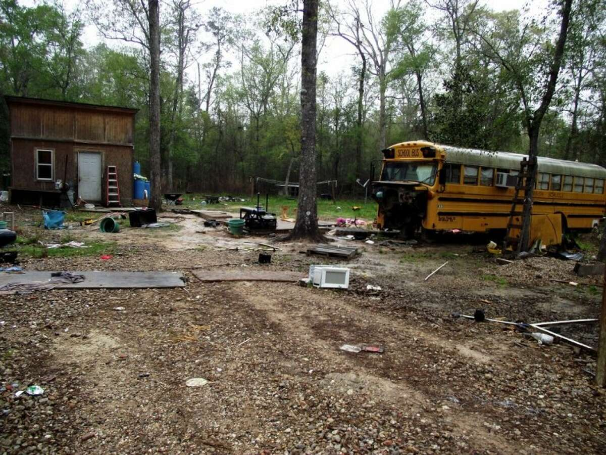 An 11-year-old girl and her 5-year-old brother were found to be living in this broken down bus on a dirt road in Splendora. The children's father was sentenced to 18 months in prison for conspiracy in January, and their mother received the same sentence in February. The children's great-aunt said she checks on them and gives them meals every day.