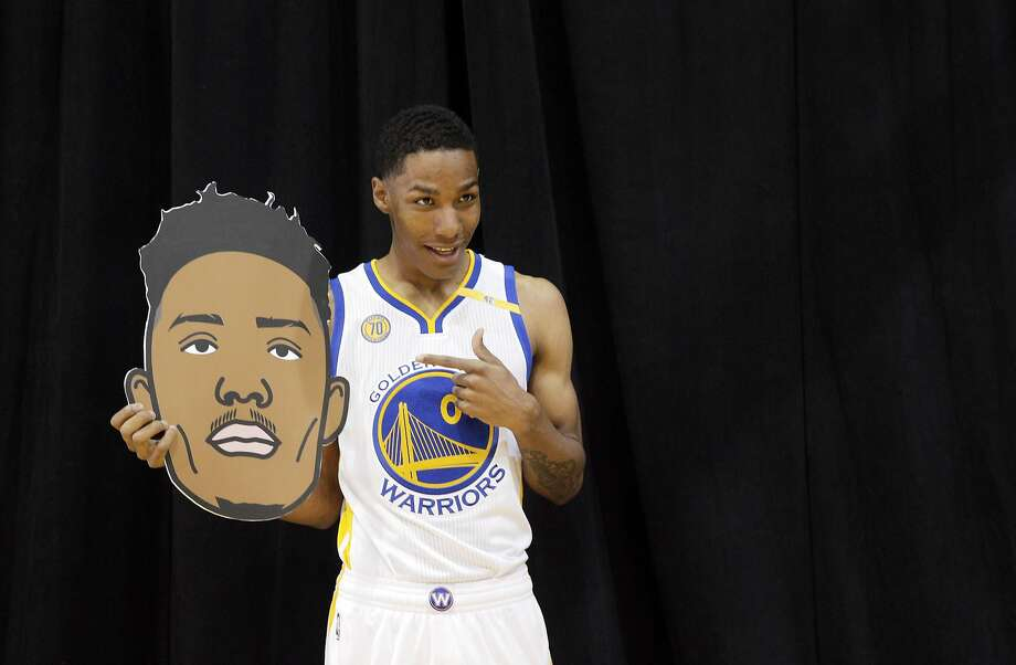 Patrick McCaw (0) poses with his emoji head during Warriors Media Day at their practice facility in Oakland, Calif., on Monday, September 26, 2016. Photo: Carlos Avila Gonzalez, The Chronicle