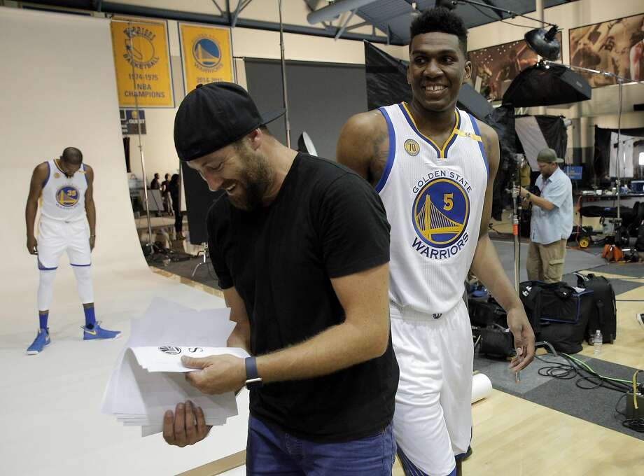 Kevon Looney (5) gets booted from his photo session when Kevin Durant (35) showed up unexpectedly during Warriors Media Day at their practice facility in Oakland, Calif., on Monday, September 26, 2016. Photo: Carlos Avila Gonzalez, The Chronicle