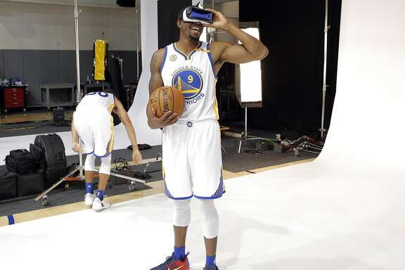 Andre Iguodala (9) plays with VR goggles during a photo shoot during Warriors Media Day at their practice facility in Oakland, Calif., on Monday, September 26, 2016.