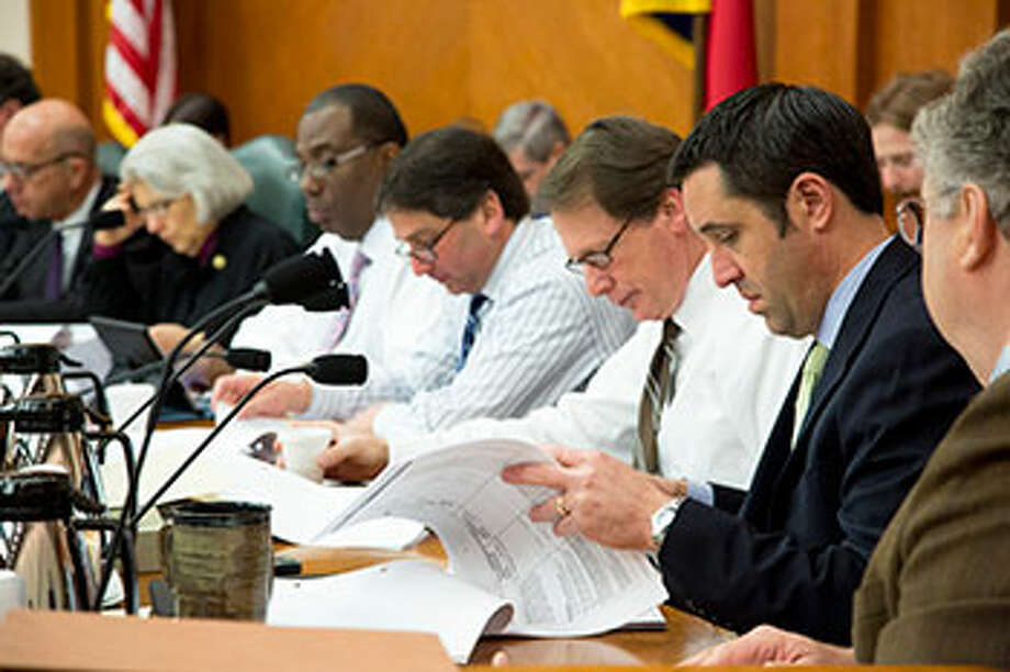 Members of the Senate Finance Committee look over the proposed budget for the state's higher education system. / Texas Senate Media Services