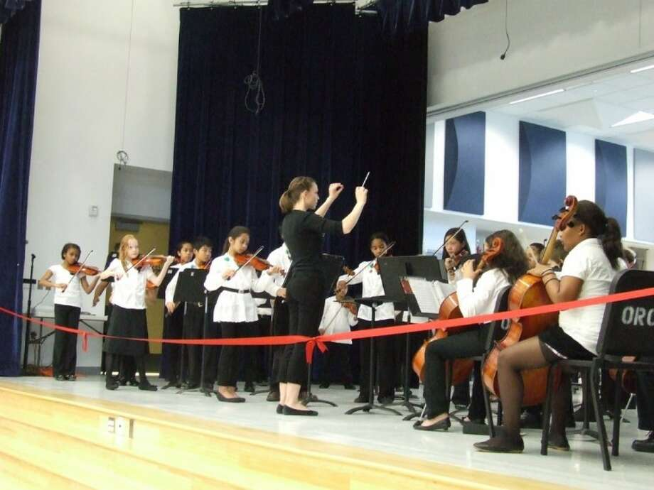 The Lovett Elementary School Orchestra plays before the dedication ceremony Thursday, March 8.