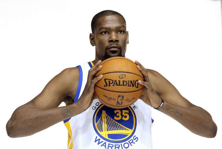 Kevin Durant (35) poses for a photo during Warriors Media Day at their practice facility in Oakland, Calif., on Monday, September 26, 2016.