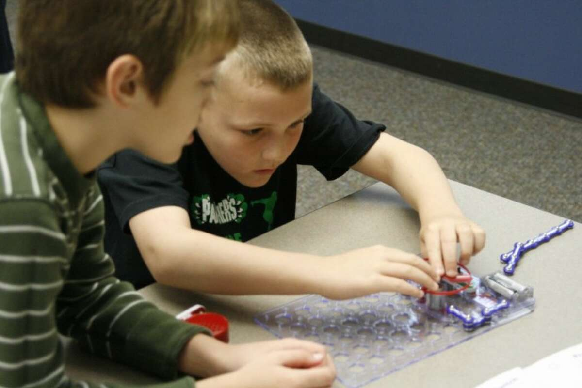 Atascocita Springs Elementary third-graders Spence Mats, right and Gavin Wilks with their partner Brendan Dagley, not pictured, work together to complete a project in the ConocoPhillips Rice Elementary Model Science Lab March 9.