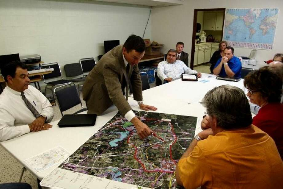 David Gornet, executive director of The Grand Parkway Association, discusses some details with Liberty County commissioners during their workshop on Wednesday morning, Feb. 27, along with representatives from the Texas Department of Transportation.