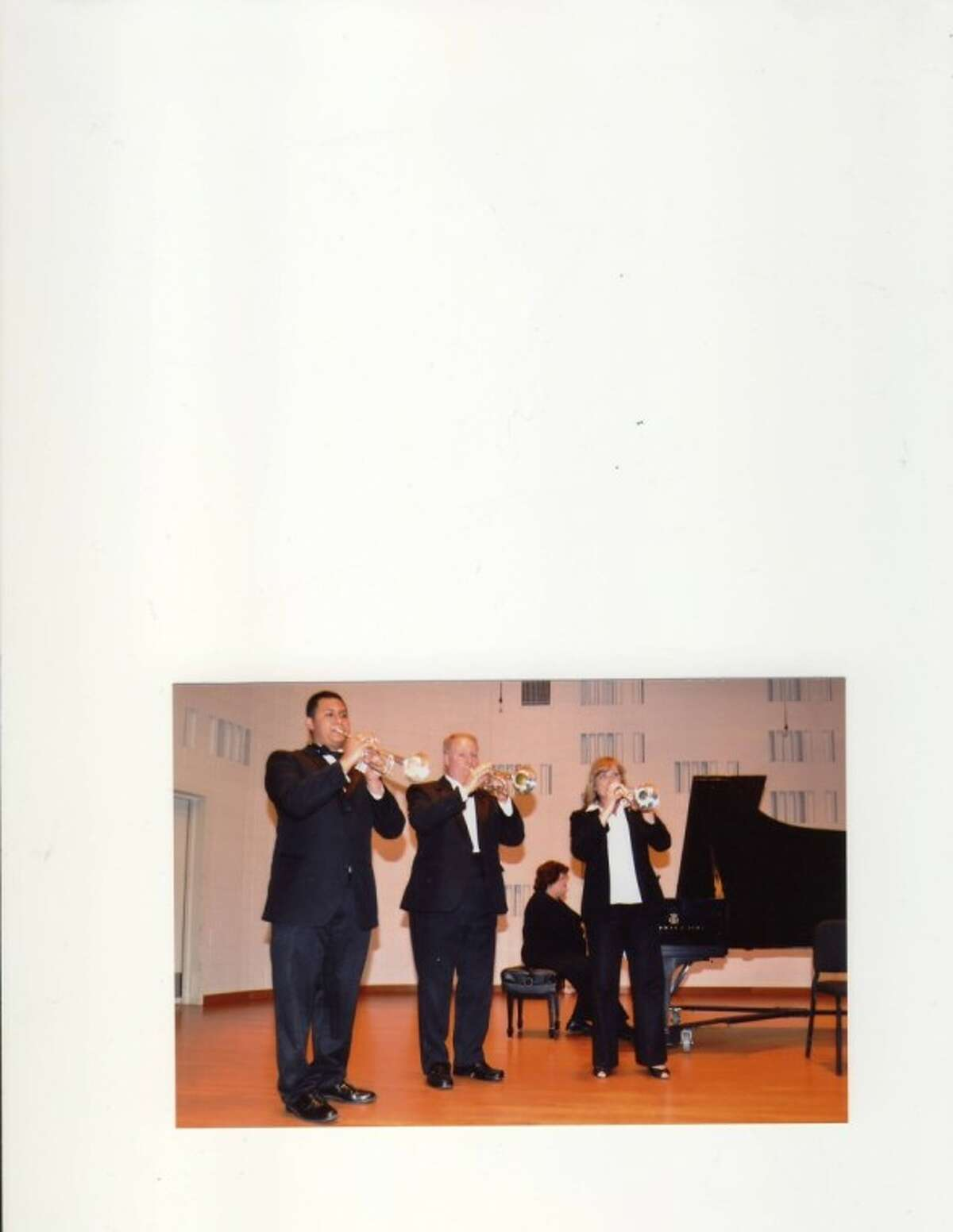 Pictured, from left, are Gumaro Gomez (trumpet), Guinn Pitts (trumpet), Kathy Mangum (piano) and Rhonda Pitts (trumpet).
