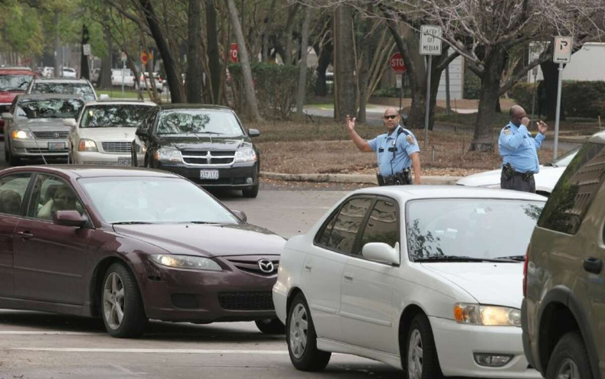 Houston Police officers try to direct spring break traffic around the Houston Museum of Natural Science on Caroline Street on Monday.