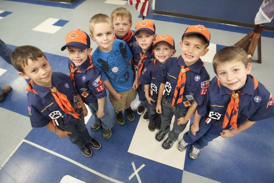 Cub Scouts Jacob Steelman, Dylan Gregg, Brandon Ruffino, Parker Horton, Christian Kelton, Bryce Chelette, Hunter Smith and Justin Treichel of Pack 1213 in Magnolia are raising money to furnish U.S. Marine Corps Cpl. Daniel Peterson's new Tomball home, built by Homes for our Troops. Not pictured is Caleb Christian.