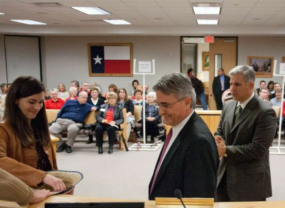 Montgomery County District Attorney candidate Tracy Pullan, left, picks a number out of a hat as fellow candidates Gilbert Garcia, center, and District Attorney Brett Ligon look on during Friday night's ballot draw. Garcia and Pullan filed Friday - the last day of filing for the May 29 primaries - to challenge Ligon. Photo: Staff Photo By Eric S. Swist