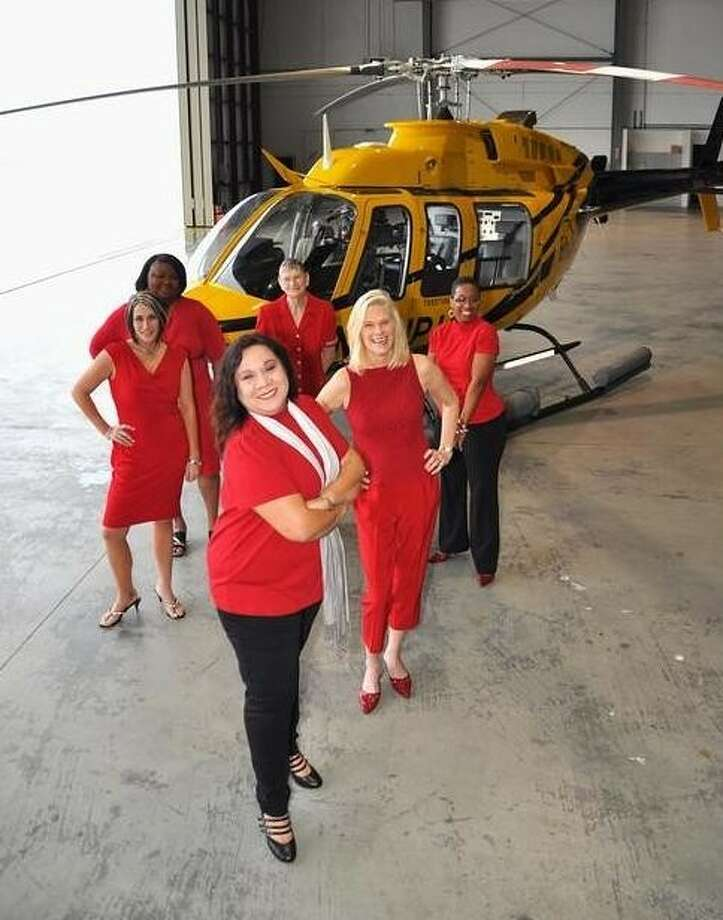 Vicki Minx (left to right), Latisha Jones, Mary Pina, Marcelene Smith, Judy Battenberg and Dana Clarke are six women, whose lives have been impacted by cardiovascular conditions. They were photographed at PHI AirMed 5's Ellington Field base as part of PHI's Go Red for Women awareness and education campaign.