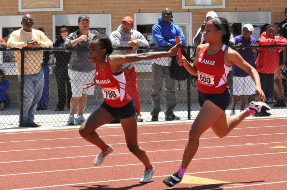 Lamar sprinter Mayorca Young hands the baton to Gabriella Handy during last year's sprint relay at the Region III-5A meet at Turner Stadium. Young won the 400 on Saturday to earn her third trip to the state meet.