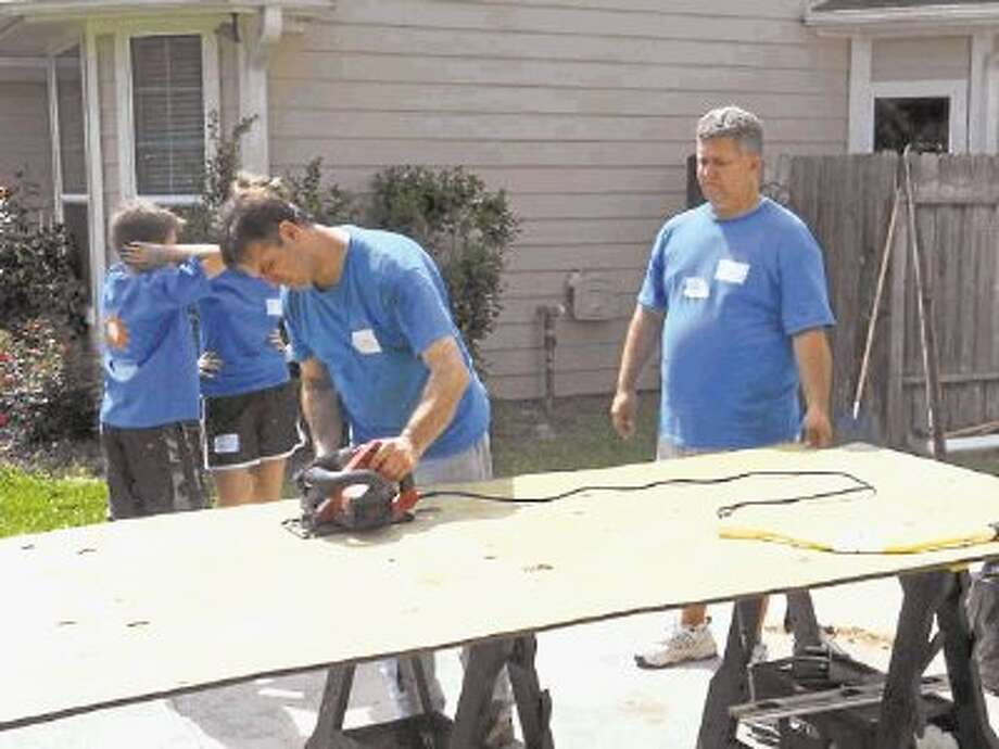 Tomball United Methodist Church members work to complete a project during last year's Faith In Action event. Photo: Submitted / @WireImgId=2614469