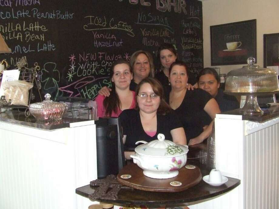 The staff at the Magnolia Tree House of Tea, Liz Mulvihill, Jessica Mulvihill, Liza Gill, Yadira Merino, Andrea Walters adn owner Chris Barton, are ready to serve you at their location on FM 1774 in Magnolia. Photo: Lindsey Vaculin
