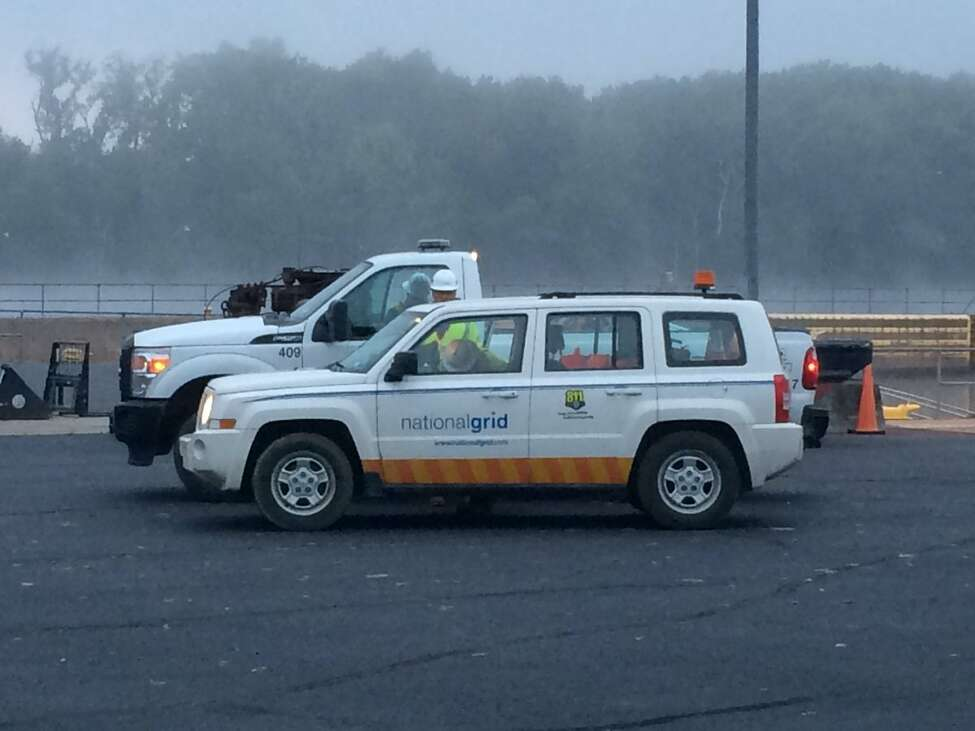 Three heavy-duty tow trucks pulled a National Grid truck out of the Hudson River in Troy on Wednesday, Sept. 28, 2016. (Emily Masters/Times Union)