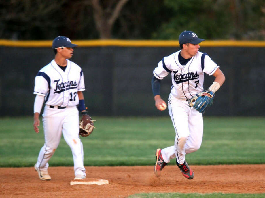 Josh Estrada of Sam Rayburn picks up a grounder and throws it to first for the out against Pearland Thursday night. Photo: Kar B Hlava