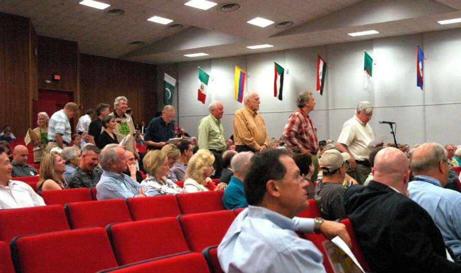 Speakers line up at the microphone Monday at the District G CIP meeting. Photo: Rusty Graham