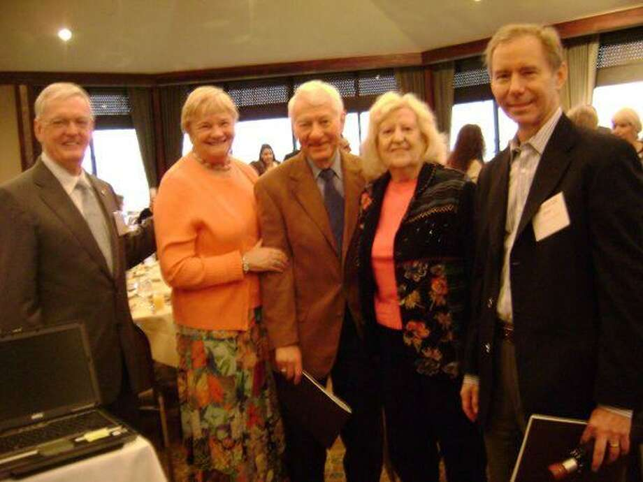 Boeing Vice President and General Manager Brewster Shaw, from right, stops to say hello to aerospace retirees Hank Hartsfield and Glynn Lunney and their wives, Fran and Marilyn, at the UH-Clear Lake Report to the Community Breakfast at Lakewood Yacht Club.