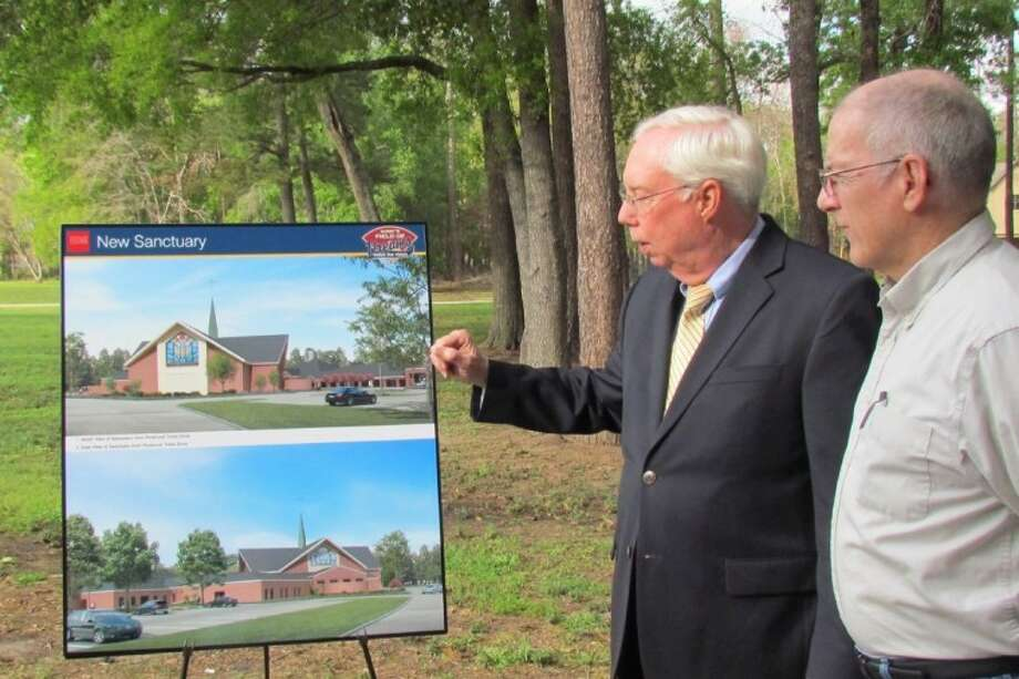 "Jim Mastin, co-chair of Atascocita United Methodist Church's ""Field of Dreams"" building campaign, discusses the architectural plans for the church's expansion with church member Ray Cox."