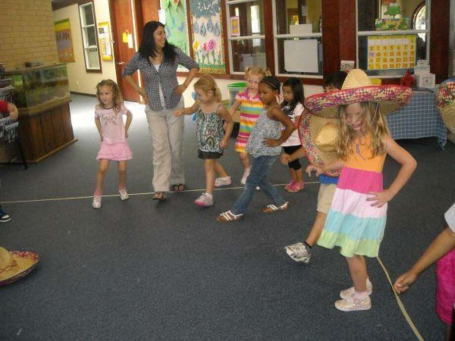 Students from the Towne Creek School dance the Mexican Hat Dance in observance of Cinco de Mayo.